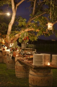 rustic table with mason jars hanging from trees