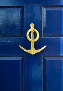 gold knocker on blue door