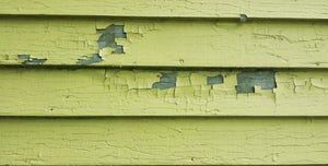 Peeling yellow paint