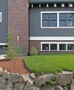 red brick with gray siding