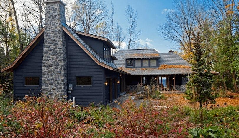 Black home exterior with landscape