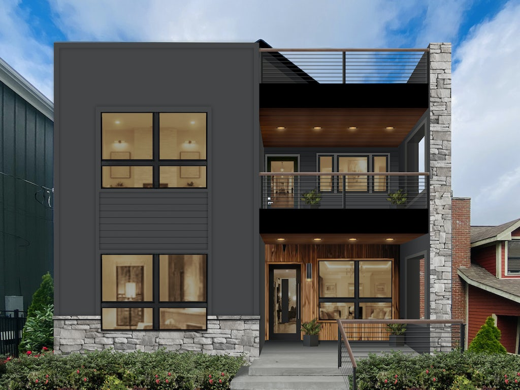 A contemporary home with gray siding and wood details