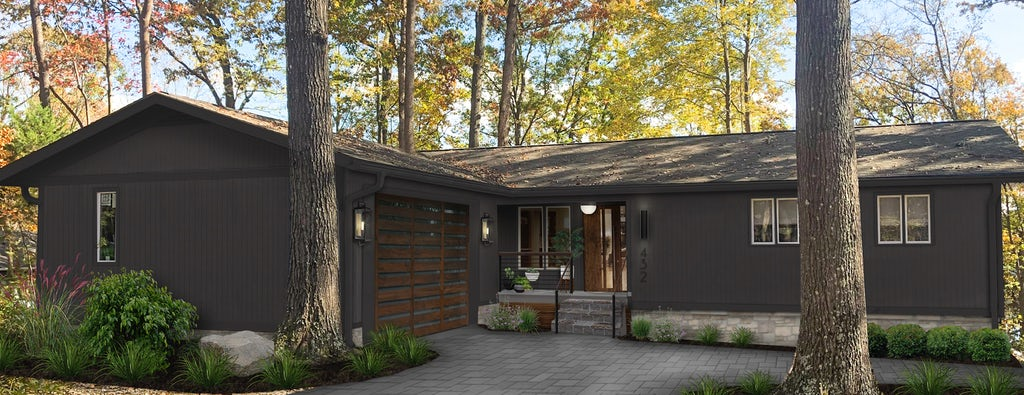 Virtual exterior design of a ranch home in the woods painted in Tricorn Black with wood accents