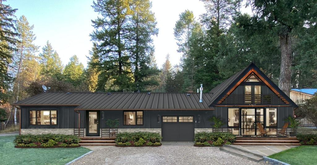 A modern home with a metal roof and stone accents painted in Soot