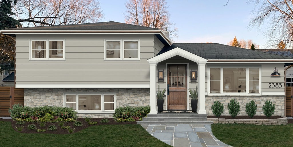 Virtual exterior design of a mid-century traditional split-level home painted in Thunder by Benjamin Moore with white trim, copper gutters, and natural stone