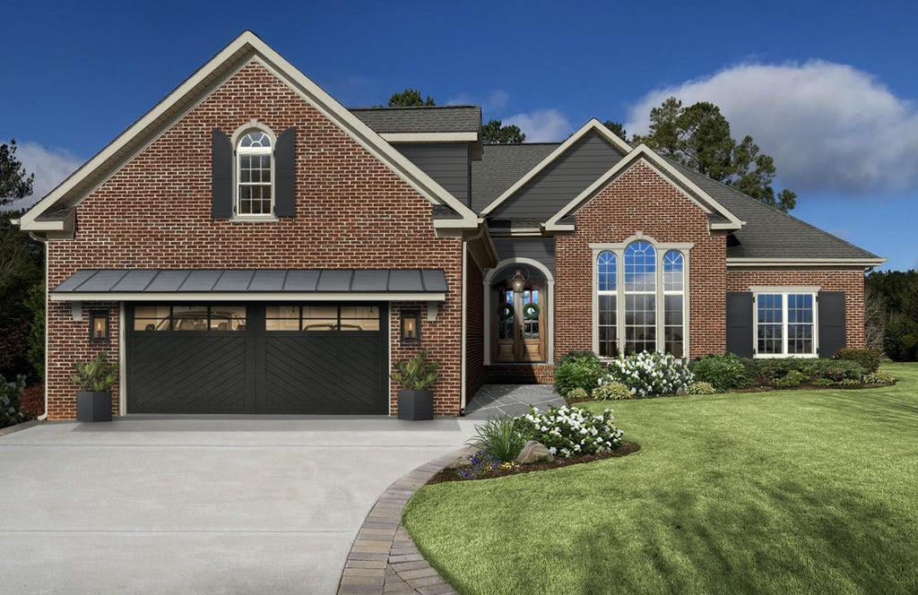 A virtual exterior home design with natural brick, dark siding and accents, and greige trim