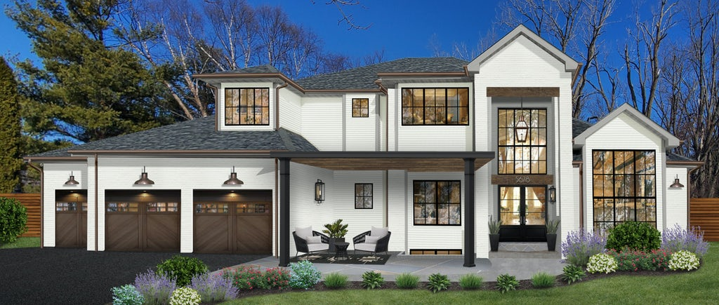 large white home with wooden garage doors and a black driveway