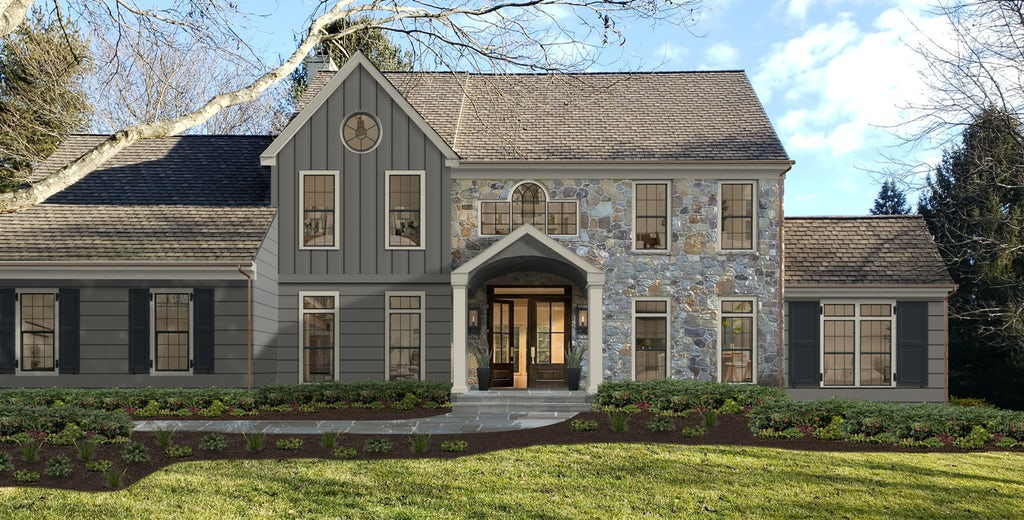 A completed stone home is partially painted with James Hardie Hardie Board siding color Aged Pewter, a peaceful gray color. The home has a beautiful front yard with lush landscaping, and a covered front entry that leads inside.