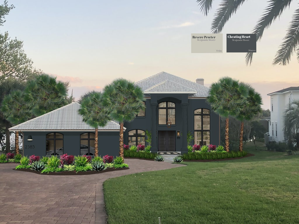 modern two story home painted in dark gray with tall windows