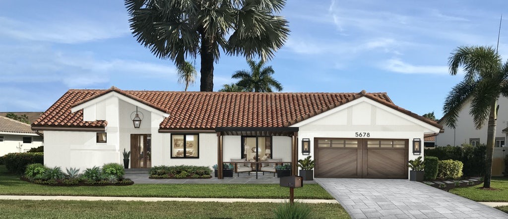 A Spanish modern home with Sherwin Williams Alabaster exterior paint paired with a clay roof