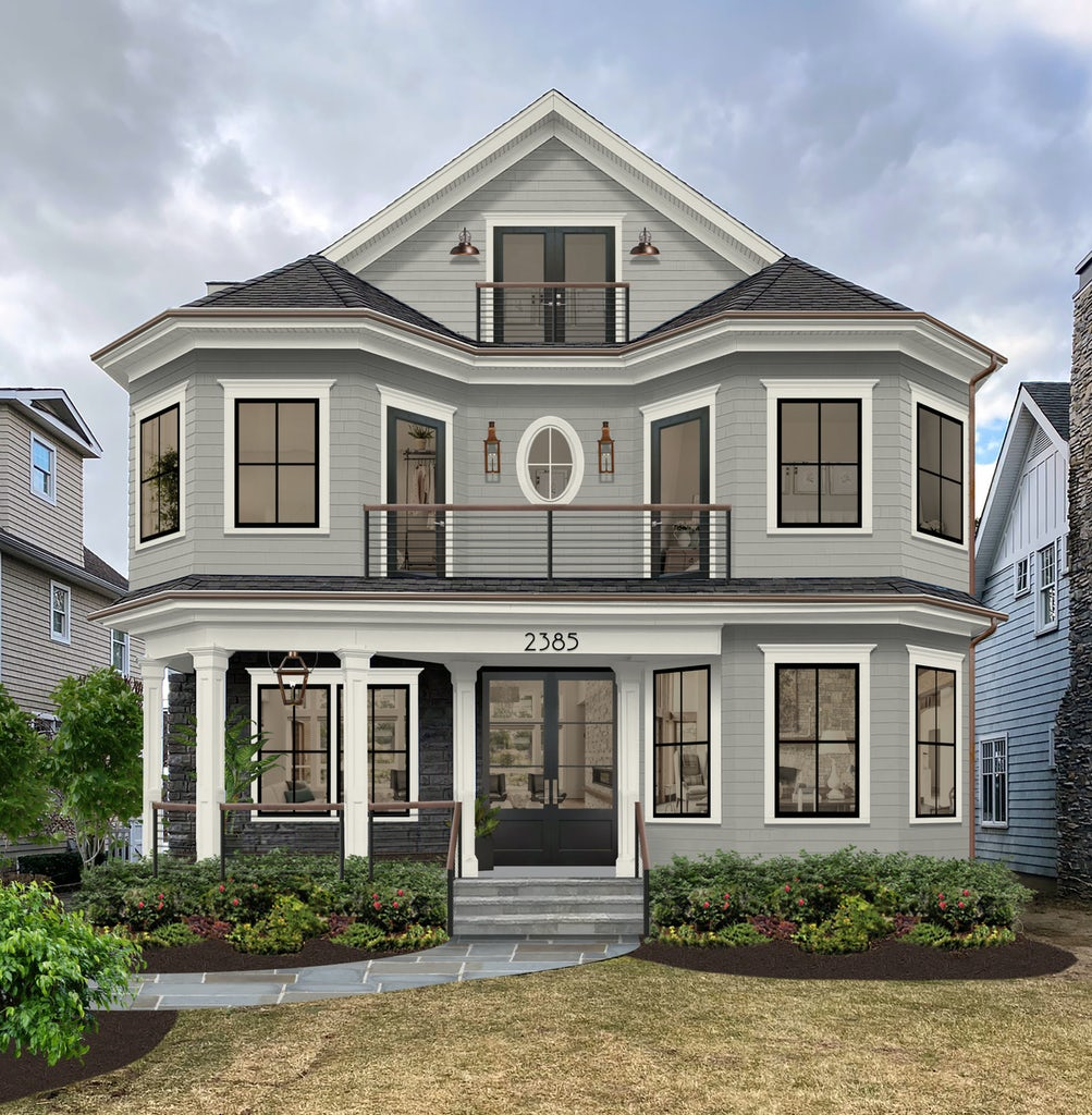 gray victorian home with large porch, turrets, and third story balcony
