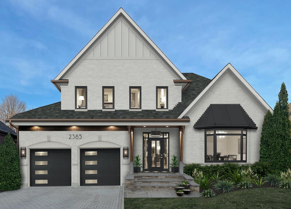 modern home with gray driveway pavers and stone walkway