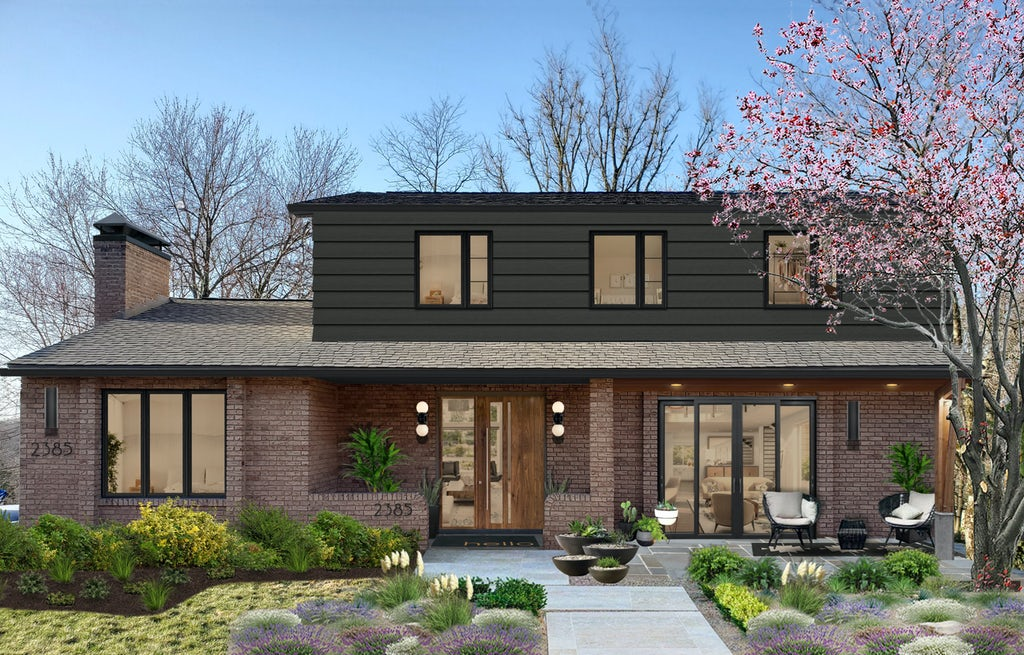 transitional two story home with iron gray paint and traditional brick