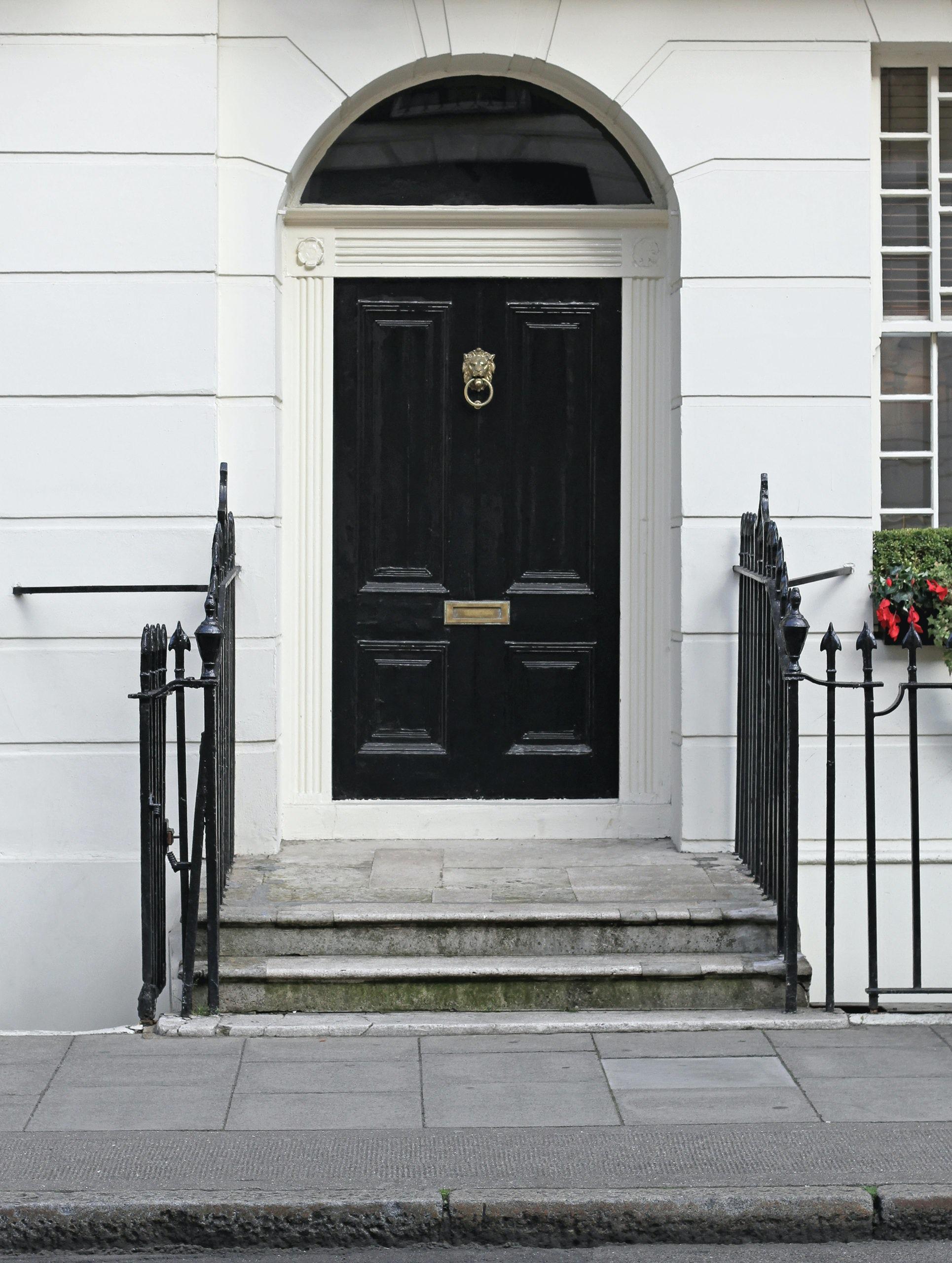 black door, brass hardware