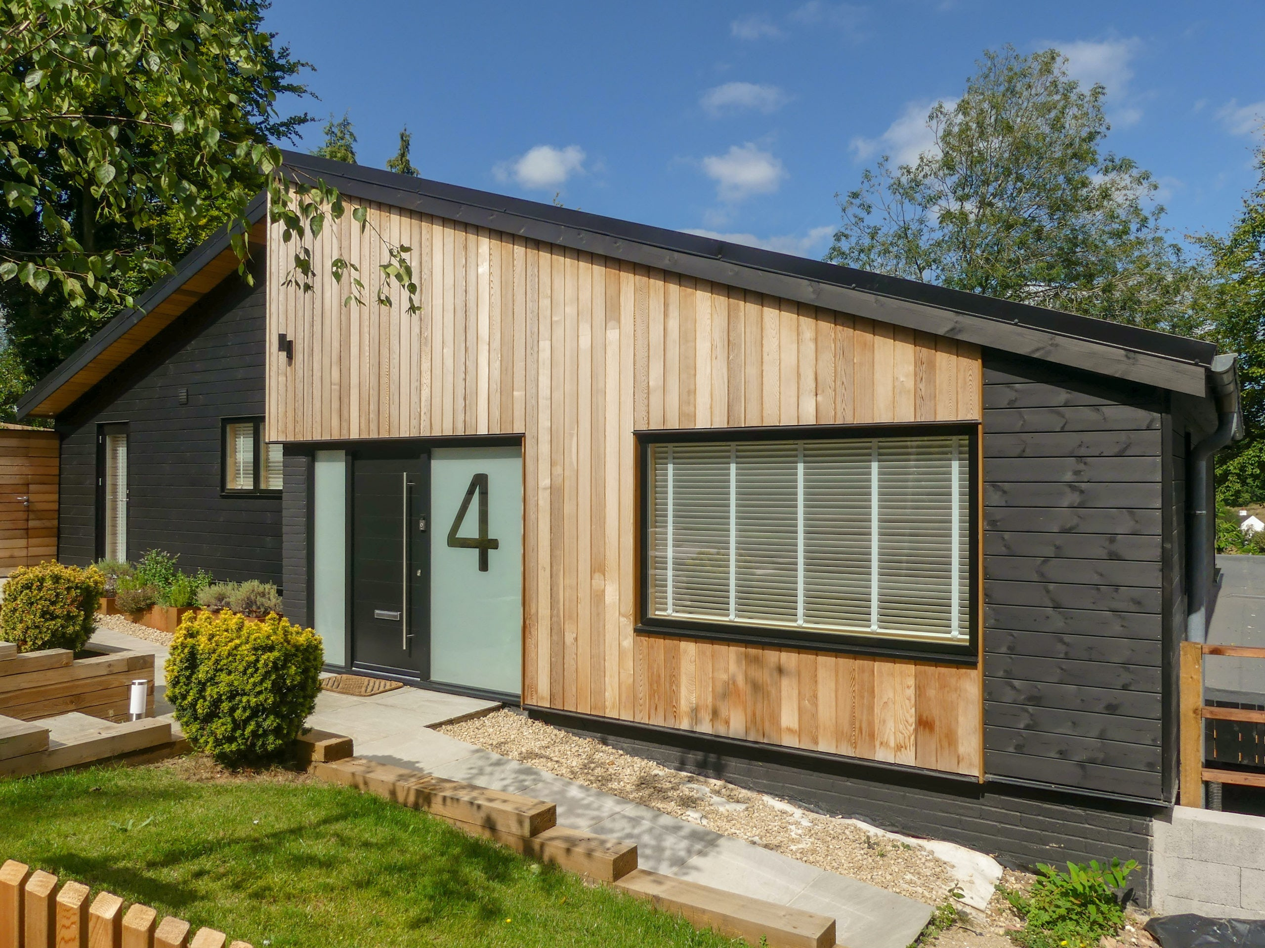 black home exterior with wood accents