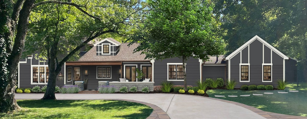 An updated exterior design of a farmhouse-style home painted in Wrought Iron by Benjamin Moore with white trim and accents.