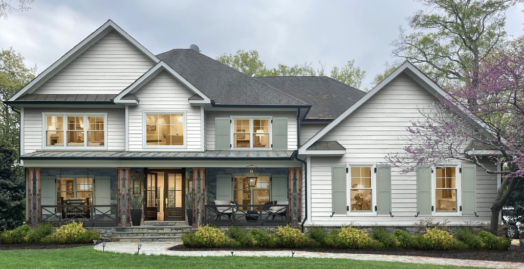 traditional home with white siding and gray shutters