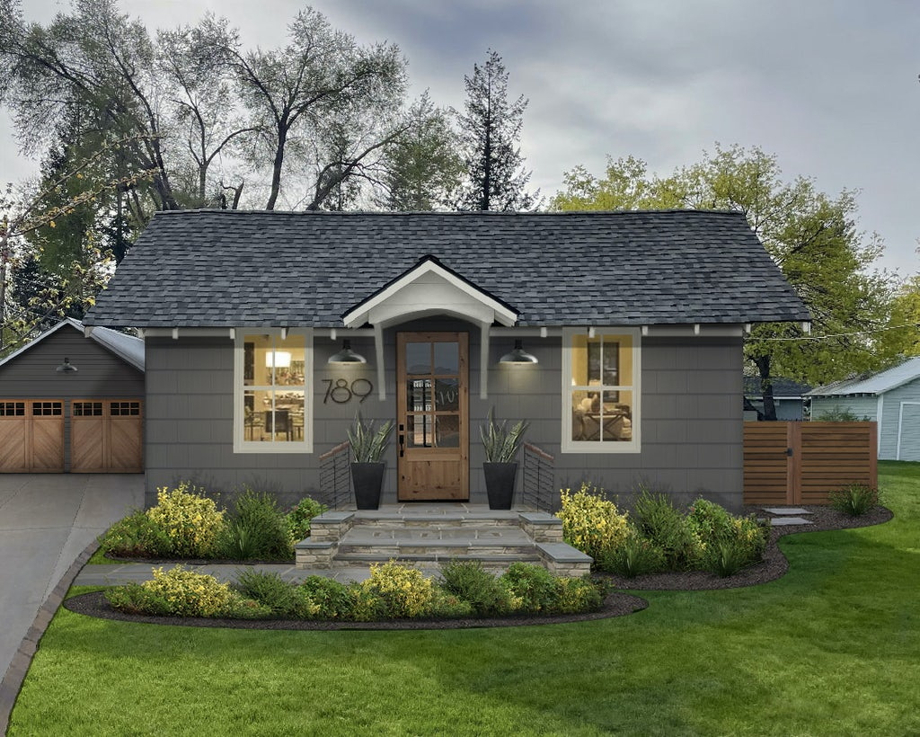small cottage home in dark gray with dover white accents and stone front porch and detached carriage style garage