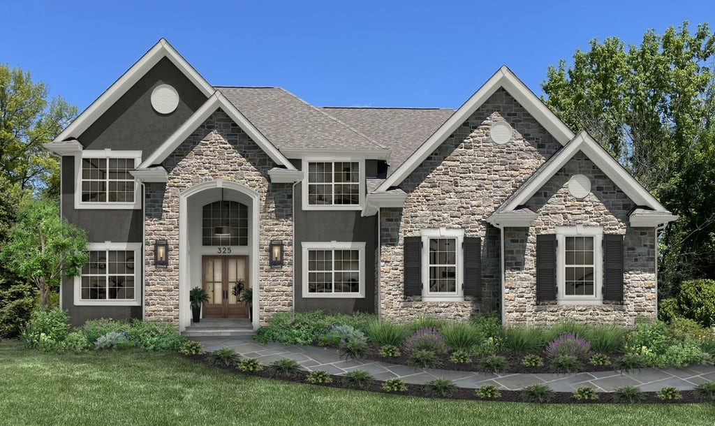 dark gray home with cultured stone and a stone walkway
