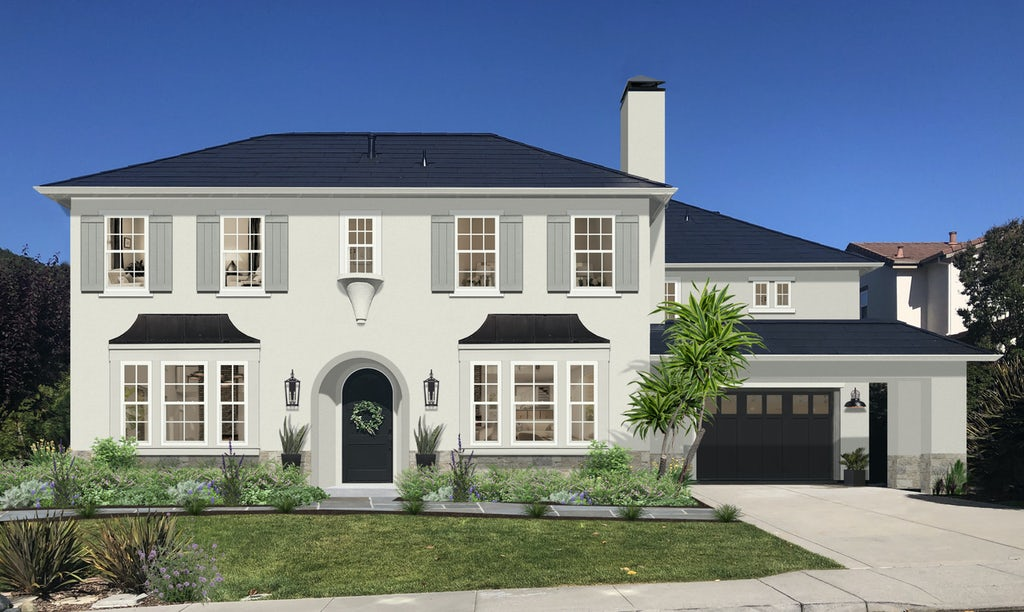 traditional white home with gray shutters and black awnings