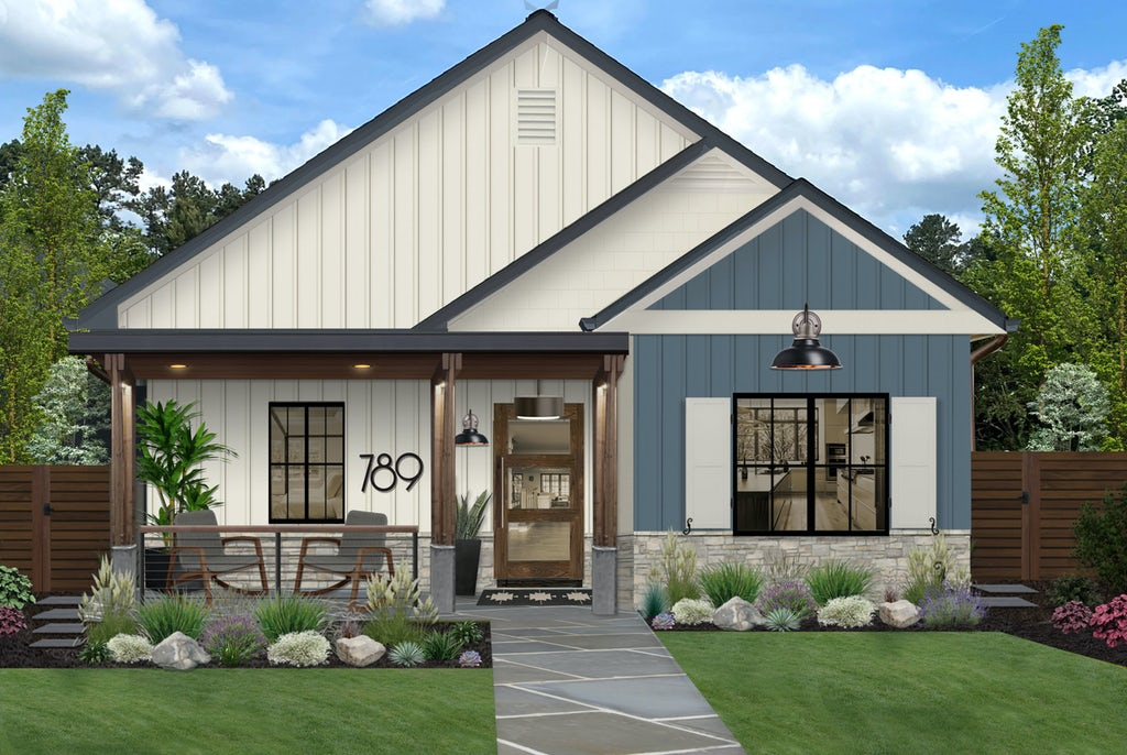 small home with white and navy siding and white shutters