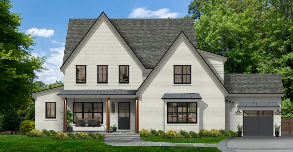 traditional white brick home with tall peaks