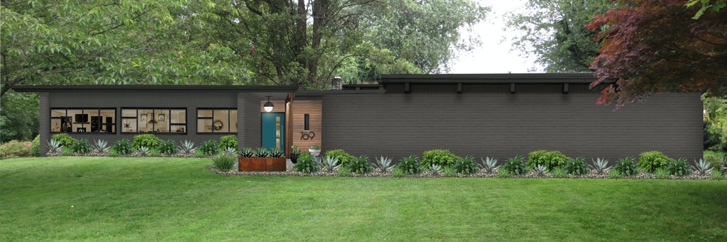 black modern ranch home with teal door and wood accents