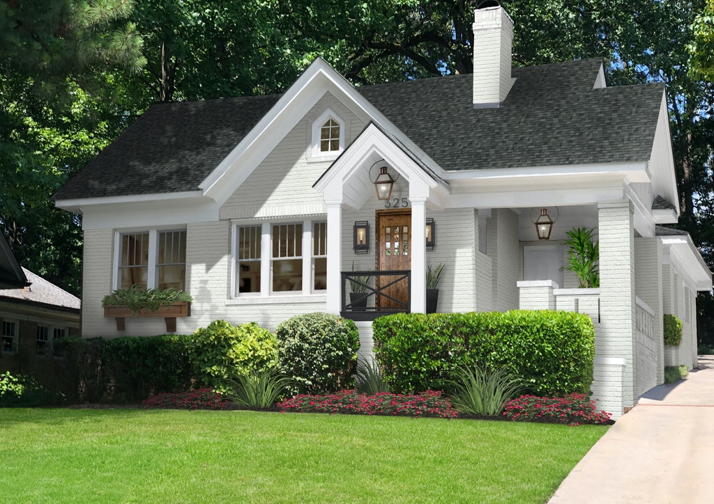 Charming brick bungalow painted white with a single flower box