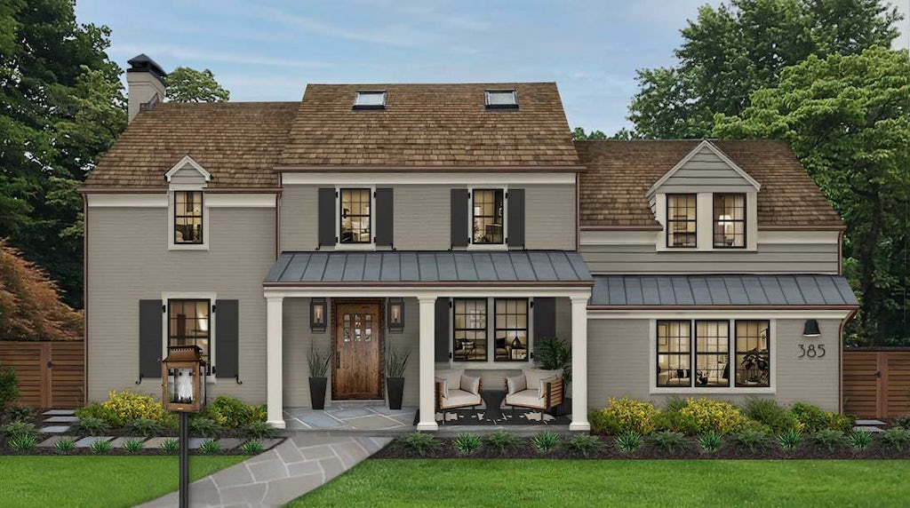 gray brick home with black shutters and white columns