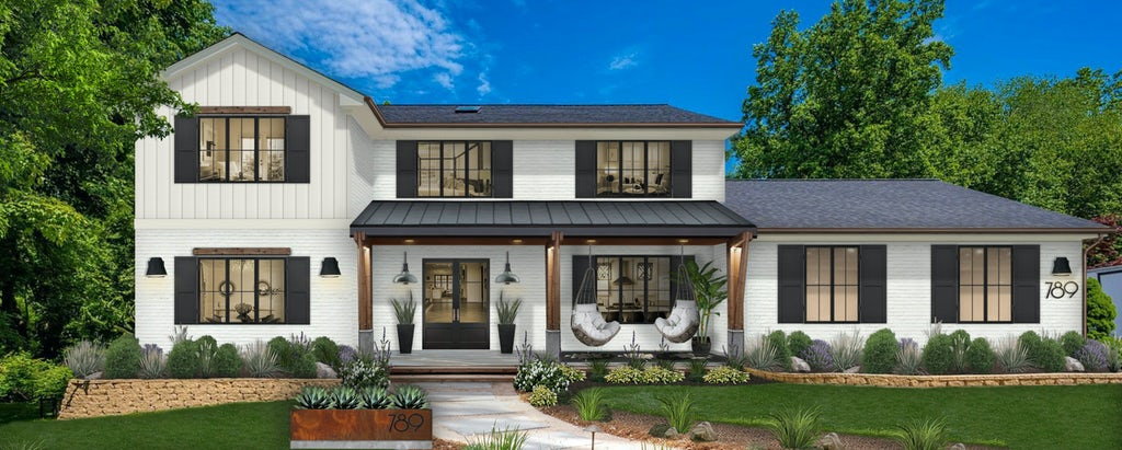 modern farmhouse with white siding and black shutters