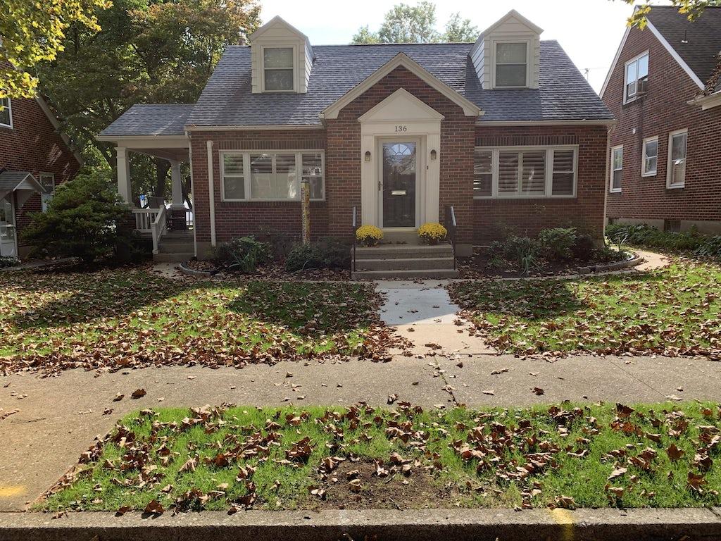 Exterior home design case study before, front facade, a brick Cape Cod home