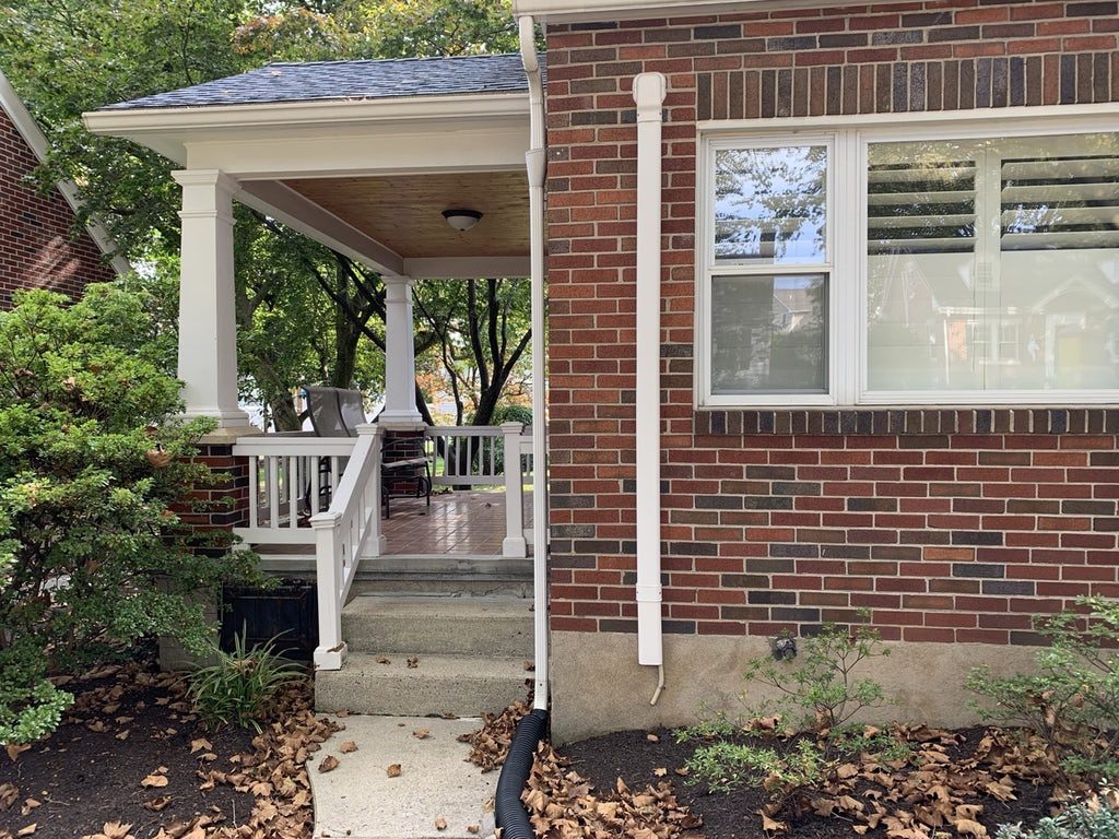 Exterior home design case study before, side porch, a brick Cape Cod home