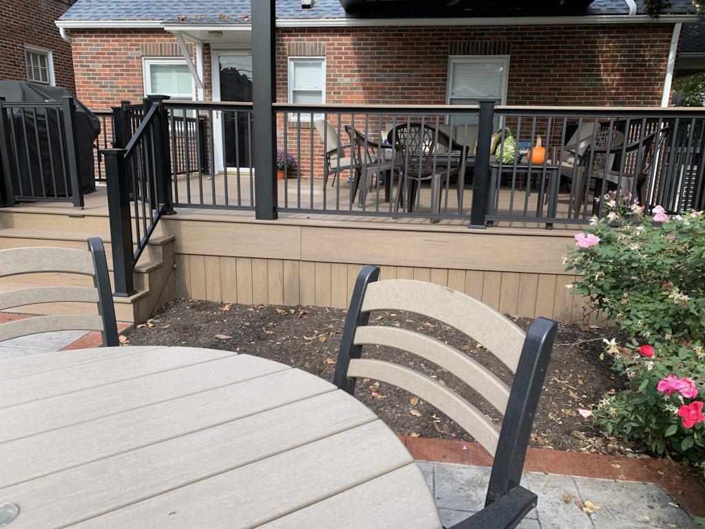 Exterior home design case study before, back deck and patio, a brick Cape Cod home